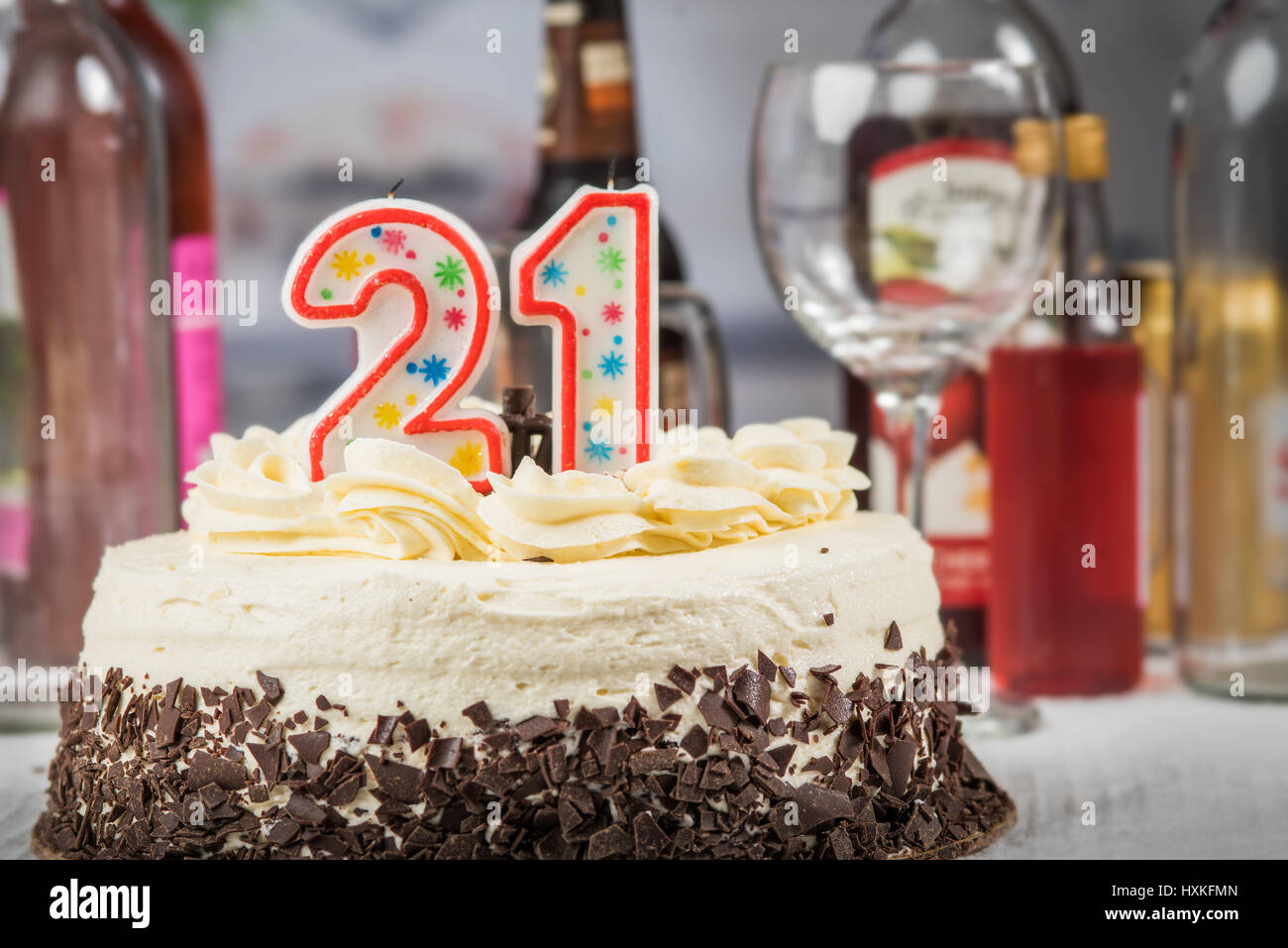 Cake With 21 Candle On It And Adult Beverages In Background