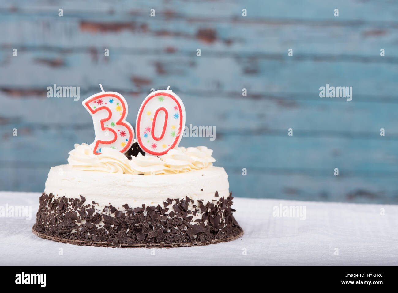 Frosted Cake With 30 Candles On It For Anniversary Or Birthday