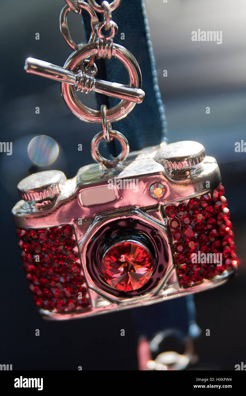 Mini camera necklace with red gems. Stock Photo