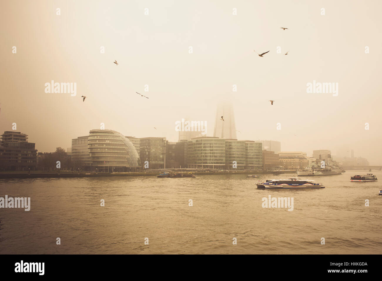View of the London under the fog from Tower Bridge with the City Hall or GLA, the Shard and its surroundings with - Stock Image