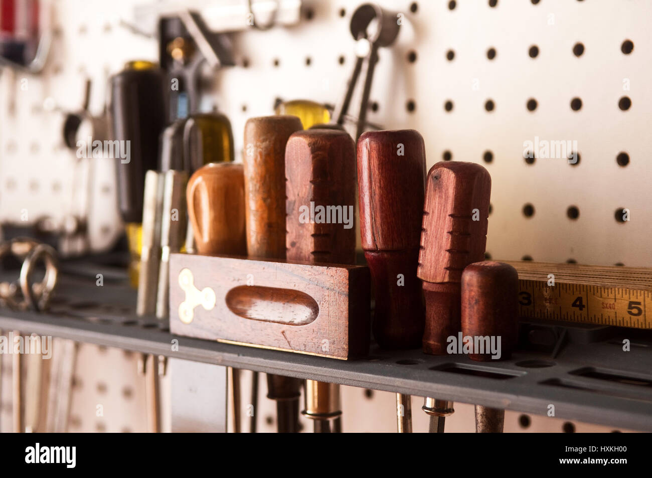 screwdriver set and tools with pegboard. Vintage wooden tools. Workshop organization. - Stock Image