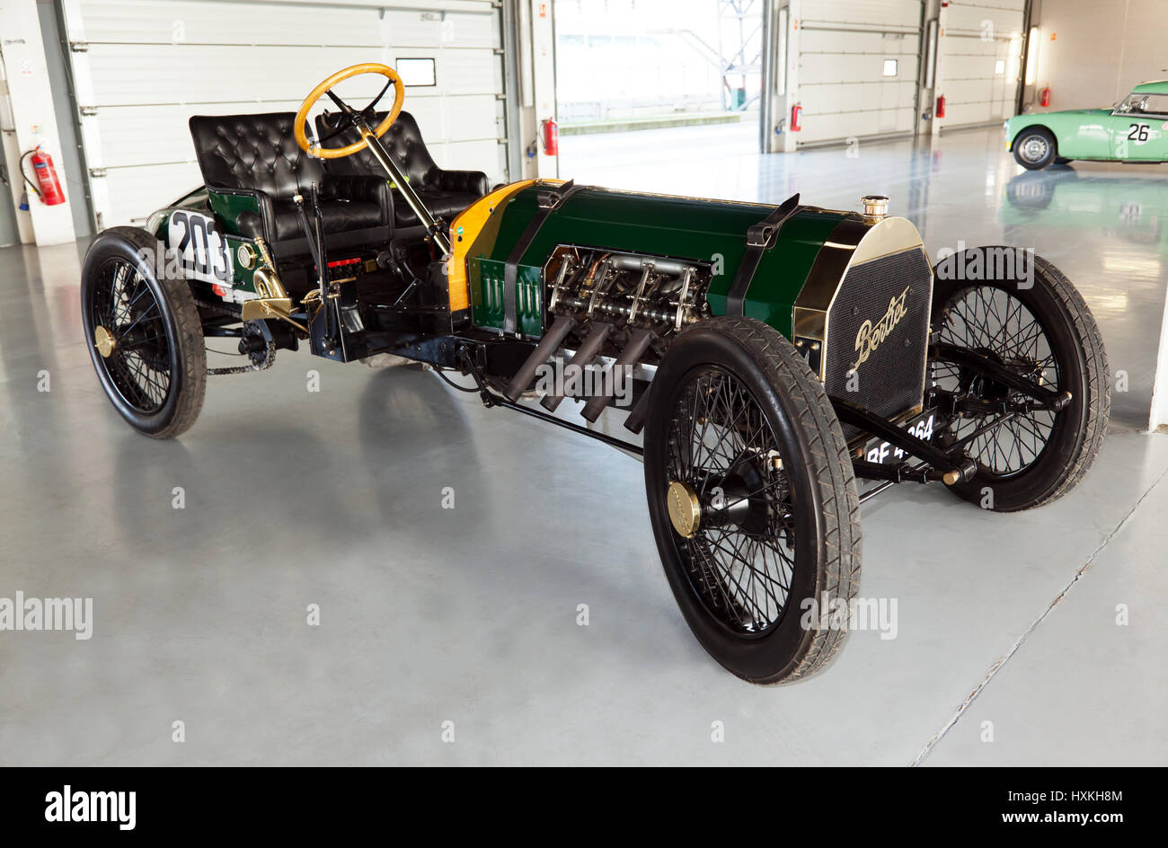 A  1909 Berliet Curtiss  race car. in the international paddock pit garages, during the Silverstone Classic Media Day Stock Photo