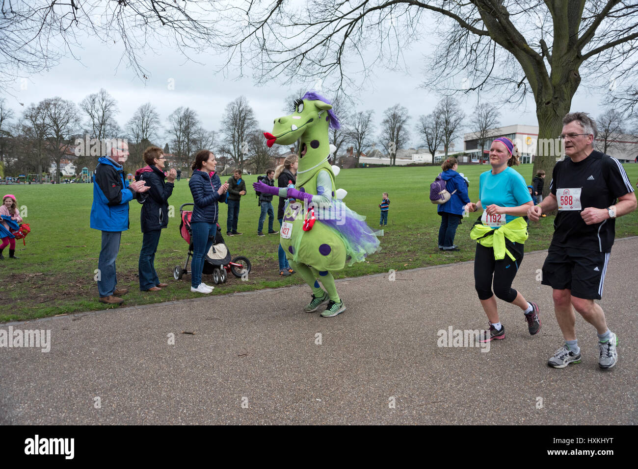 Runners pass through The Quarry park in the Shrewsbury 10k race, March 2017 - Stock Image