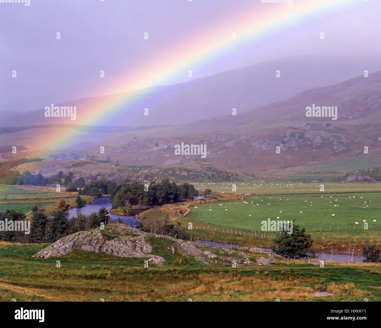 River scene with rainbow, Highland, Scotland, United Kingdom - Stock Image