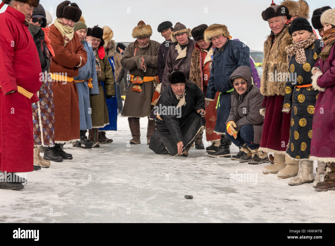 Local community celebrating the recovery of their lake from destruction by a  mining company with an ice festival - Stock Image