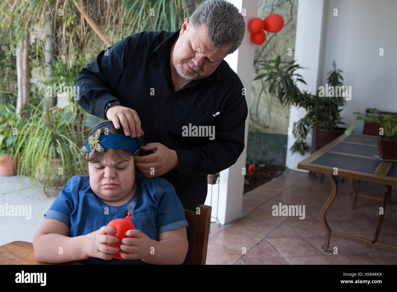 Ana Ximena Navarro and her father Jesús Navarro Torres, at their home in Guadalajara, Mexico on February 22, - Stock Image