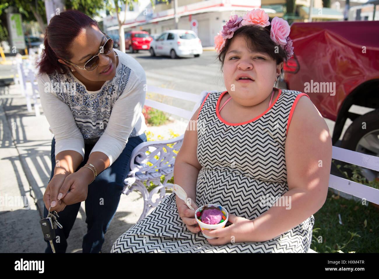 Ana Ximena Navarro (R) and her aunt Gabriela Rios Ballesteros (L), eat an ice cream in Guadalajara, Mexico on February - Stock Image