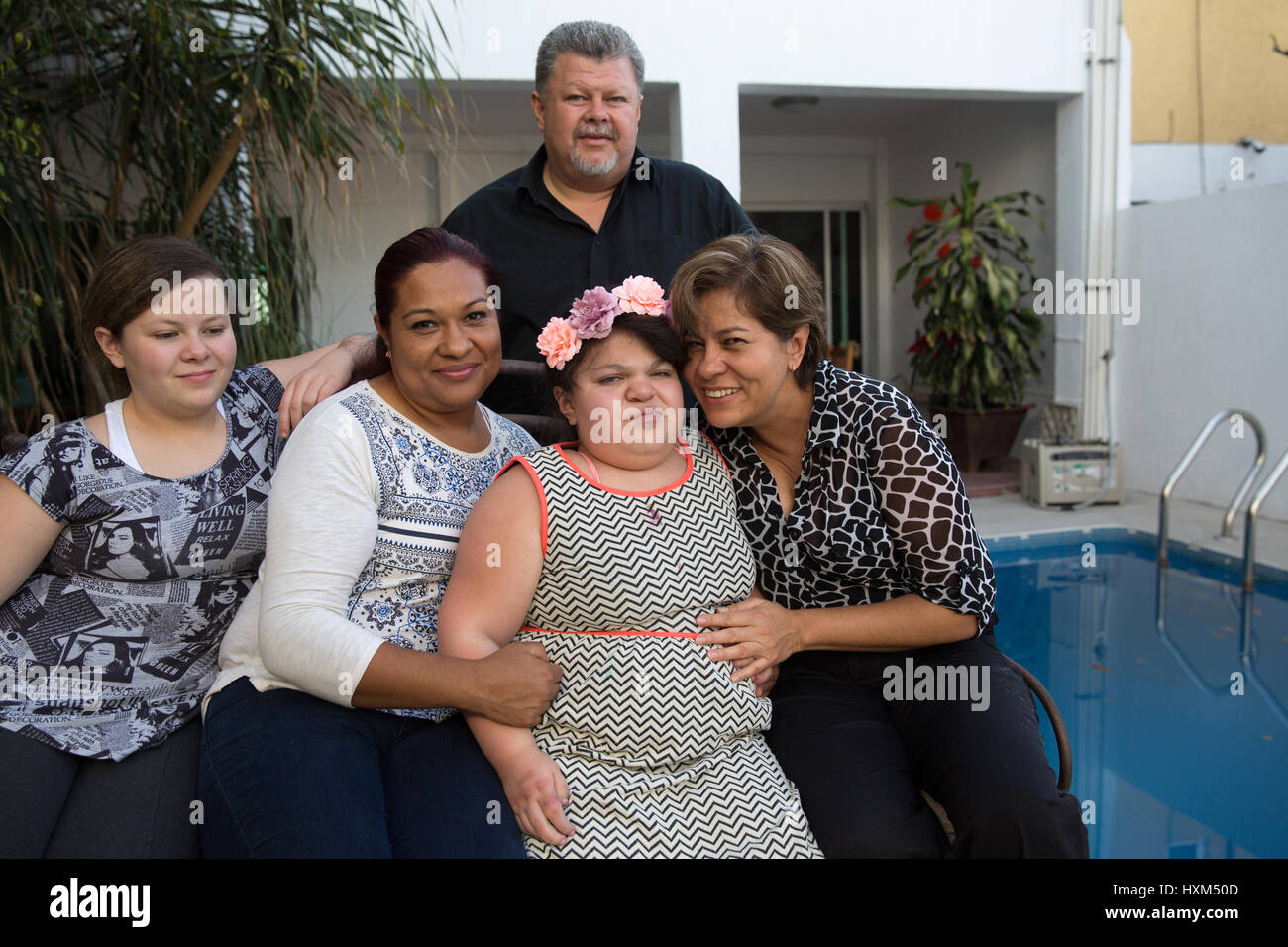 Ana Ximena Navarro (C) and her family are pictured at their home in Guadalajara, Mexico on February 22, 2017. Ximena - Stock Image