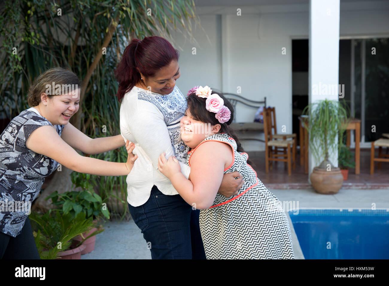 Ana Ximena Navarro (R) playing with her aunt Gabriela Rios Ballesteros (C) and her sister Ana Yamila Navarro (L), - Stock Image