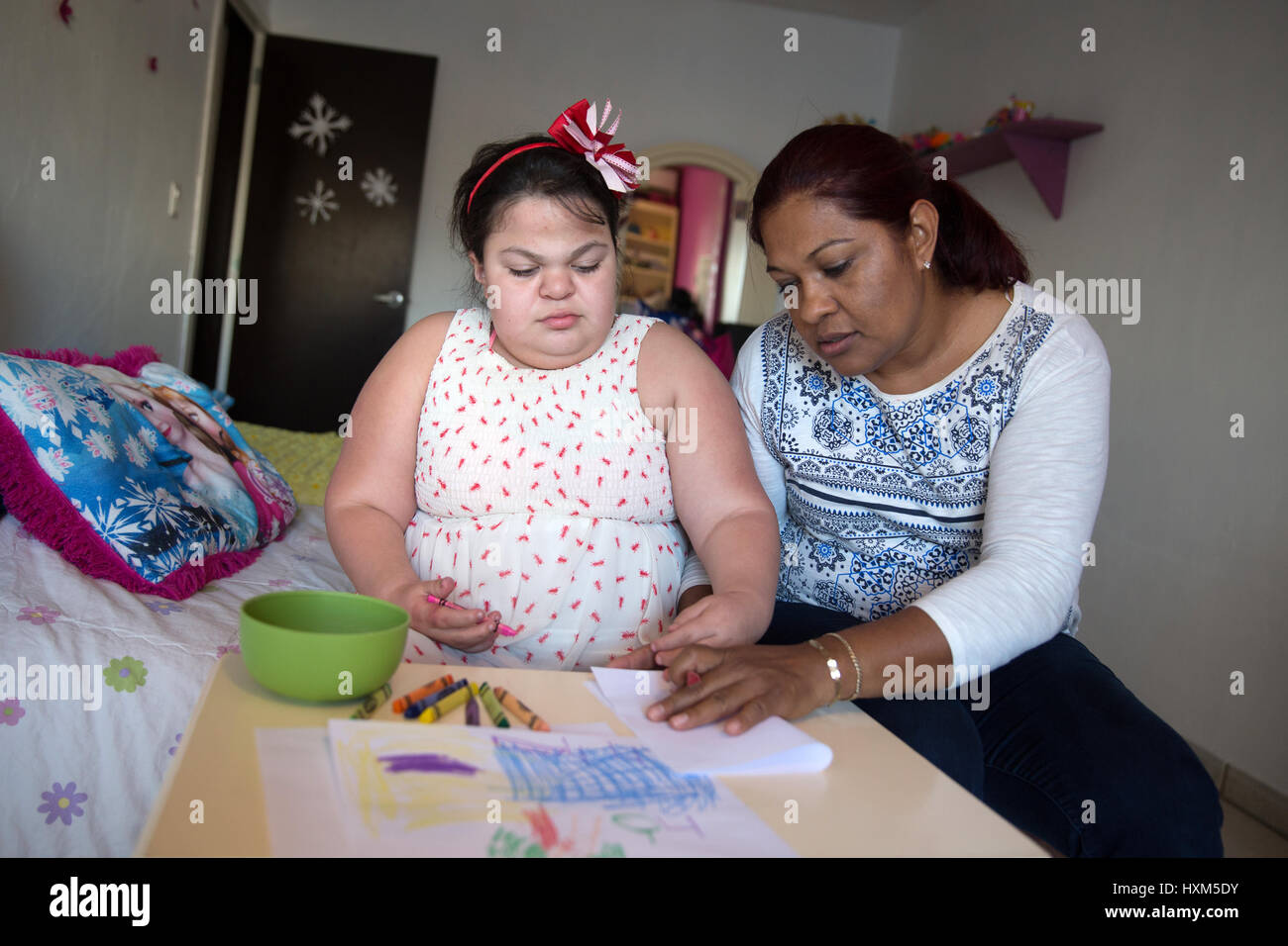 Ana Ximena Navarro (L) is pictured drawing with her aunt Gabriela Rios Ballesteros (R), at her home in Guadalajara, - Stock Image