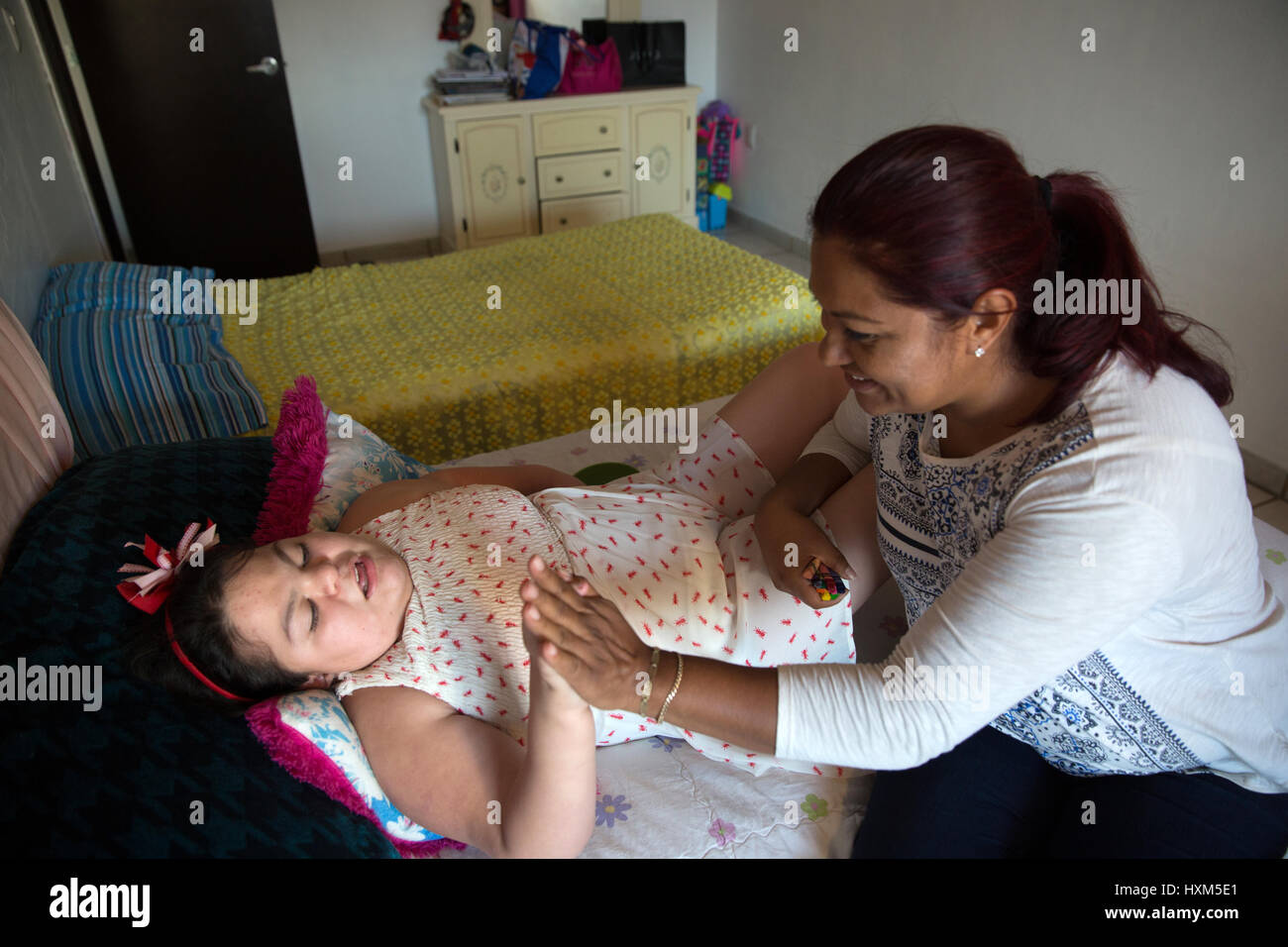 Ana Ximena Navarro (L) is pictured playing with her aunt Gabriela Rios Ballesteros (R), at her home in Guadalajara, - Stock Image
