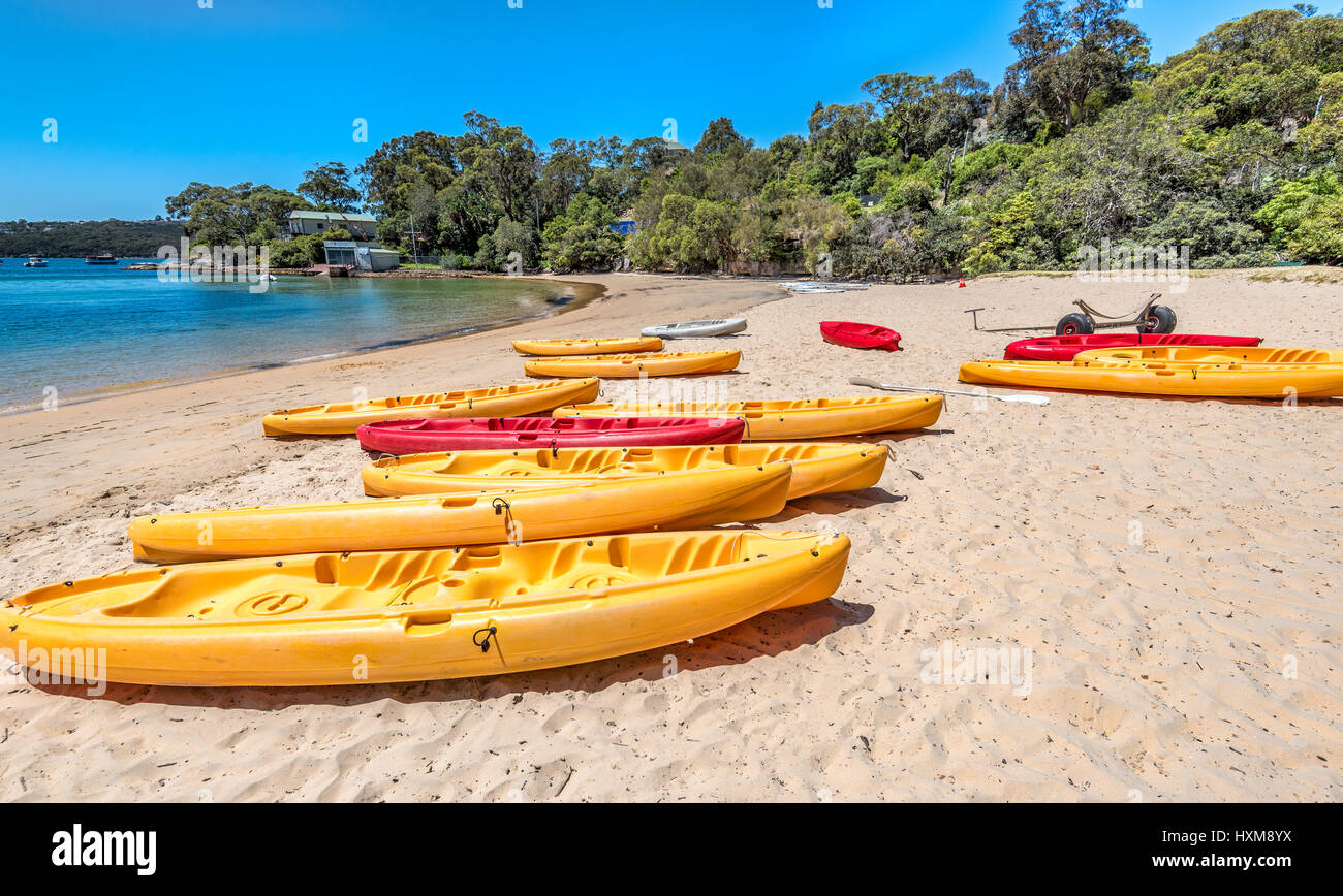 Yellow and red kayaks on the beach - Stock Image
