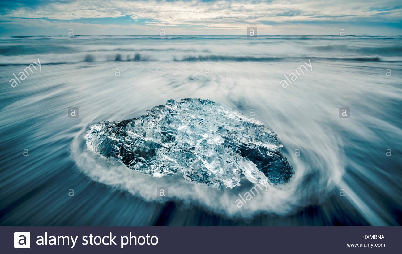 Ice on the beach near Jokulsarlon Lagoon in Southern Iceland - Stock Image