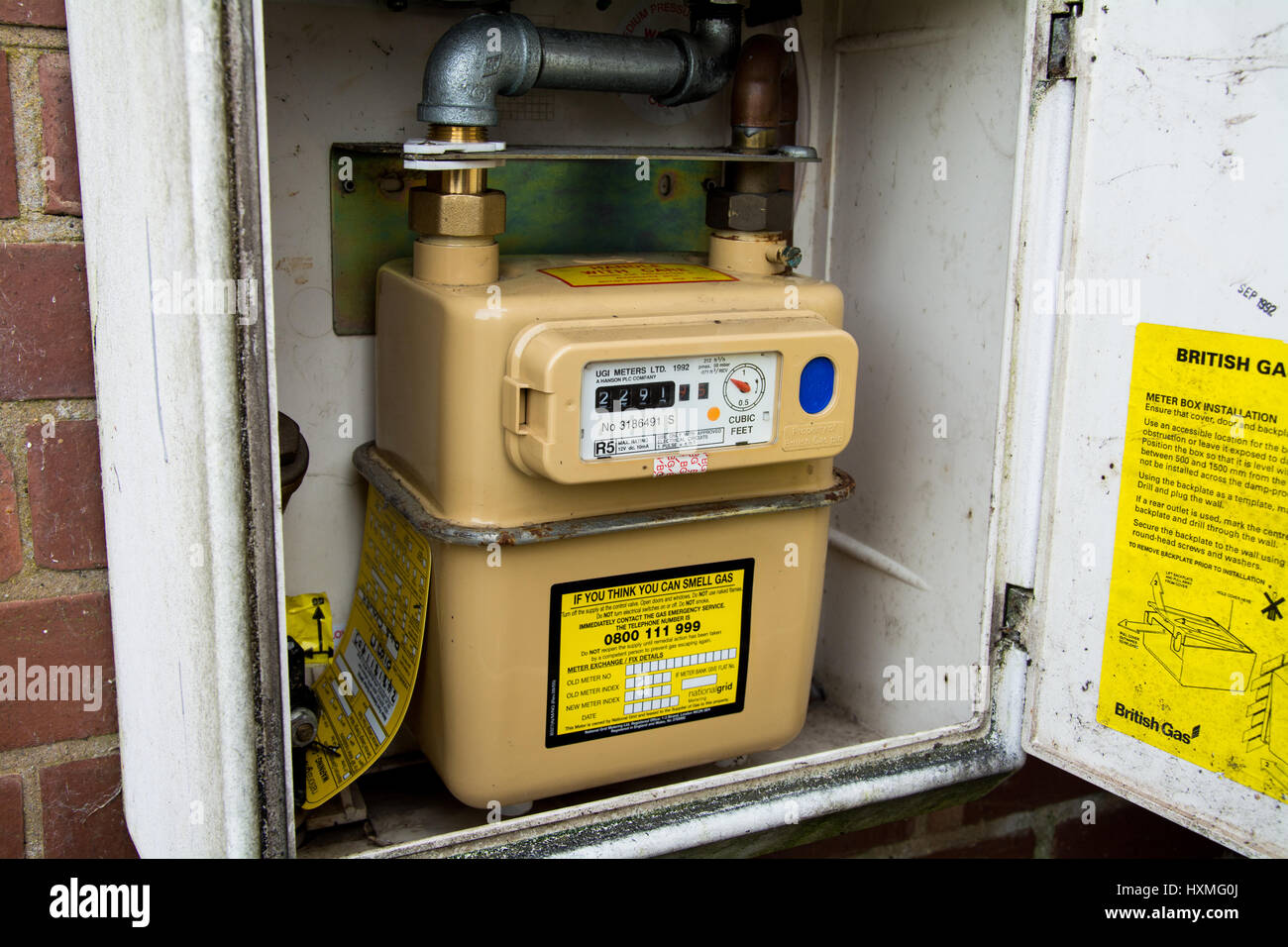 Taking a gas meter reading in the UK. - Stock Image