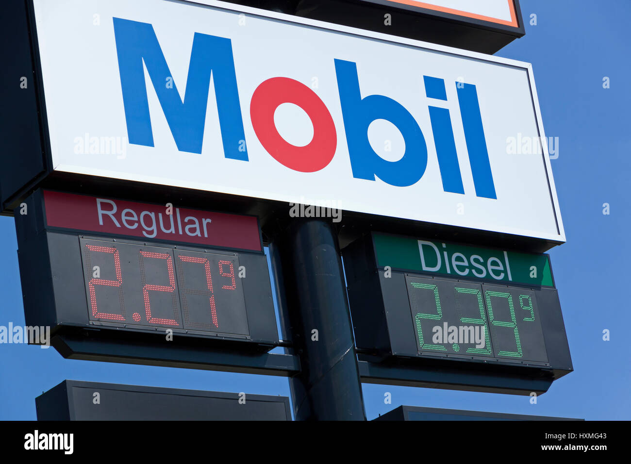 Mobil sign advertising regular and diesel low gas prices. - Stock Image