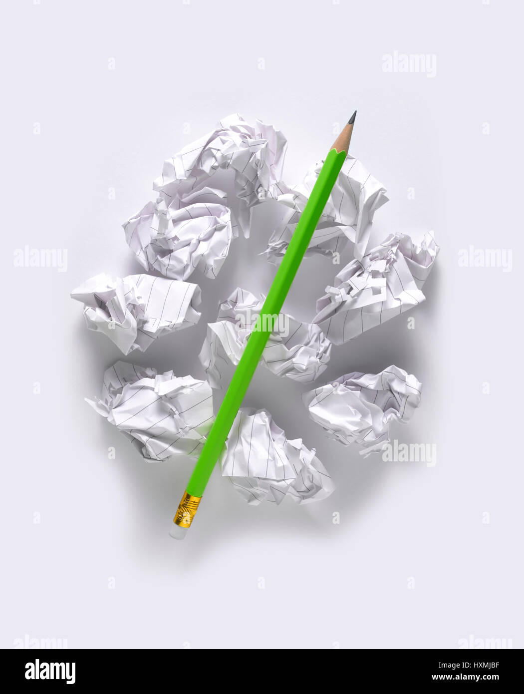 gren pencil isolated on scrunched paper Stock Photo