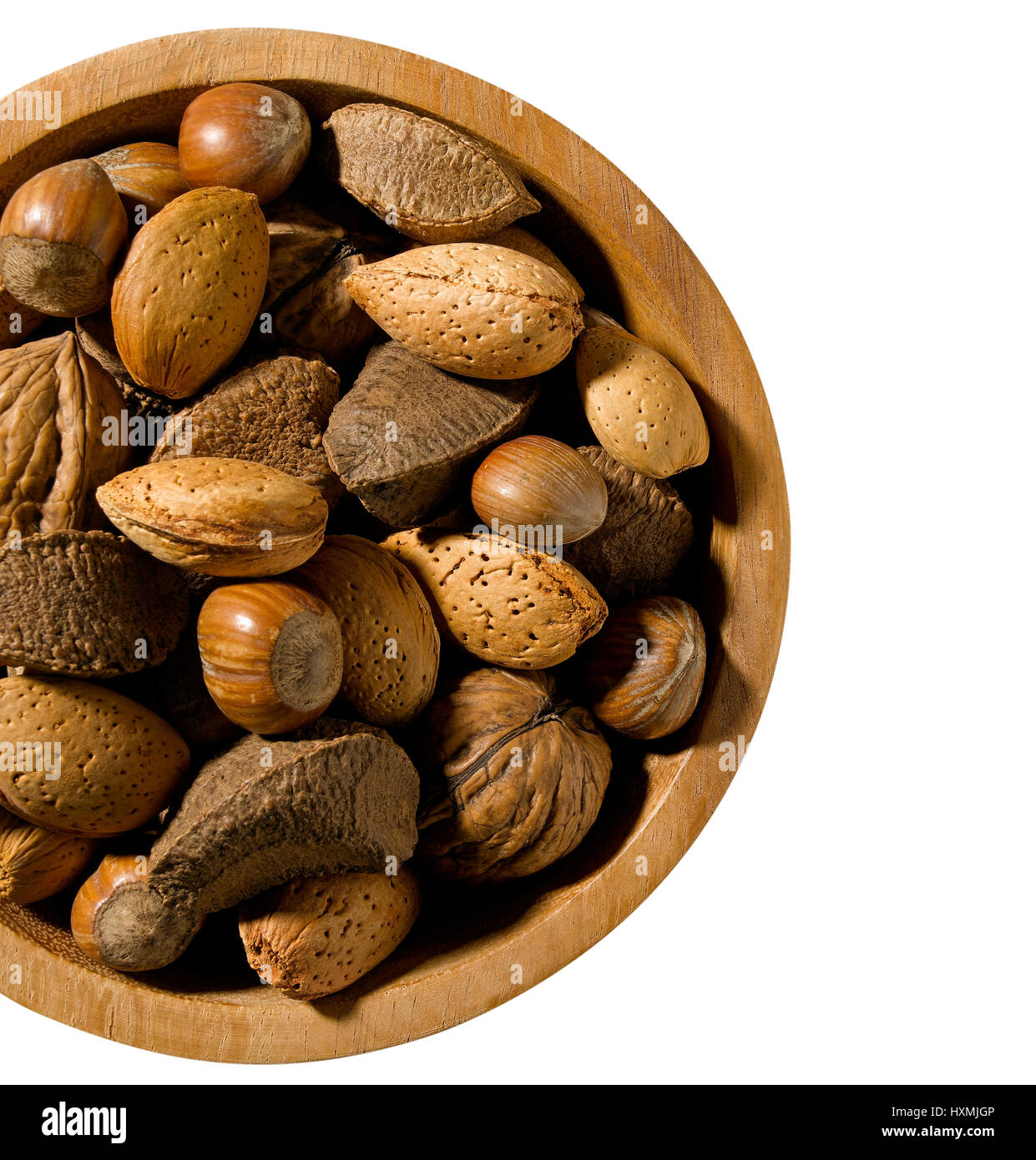 Mixed nuts in bowl on white - Stock Image