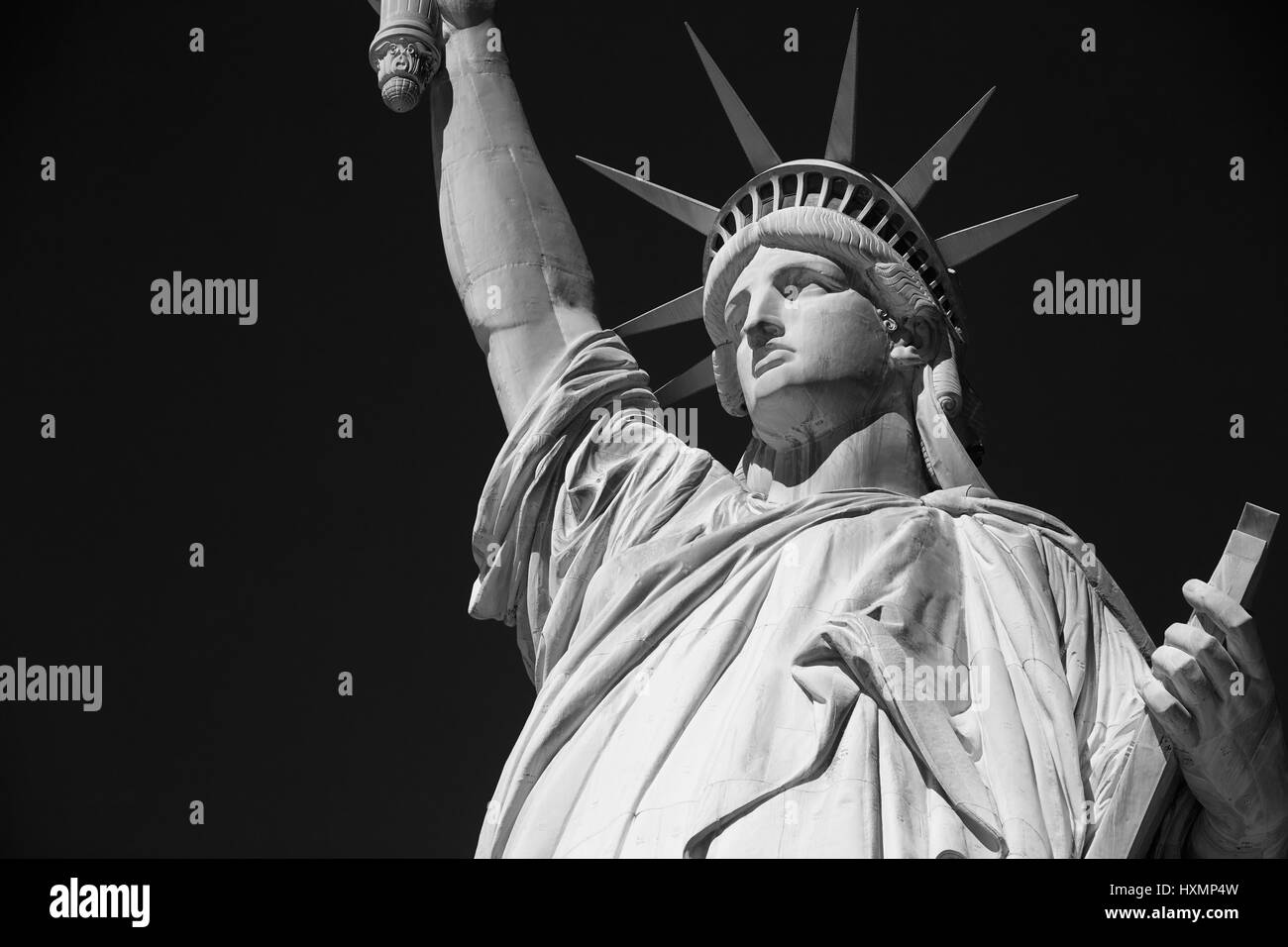 Statue of Liberty, black and white with black sky in New York - Stock Image