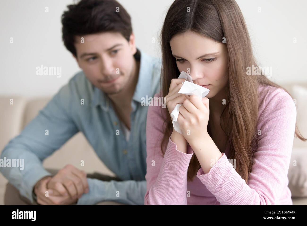 Guy comforting crying woman, boyfriend supporting upset girlfrie Stock Photo