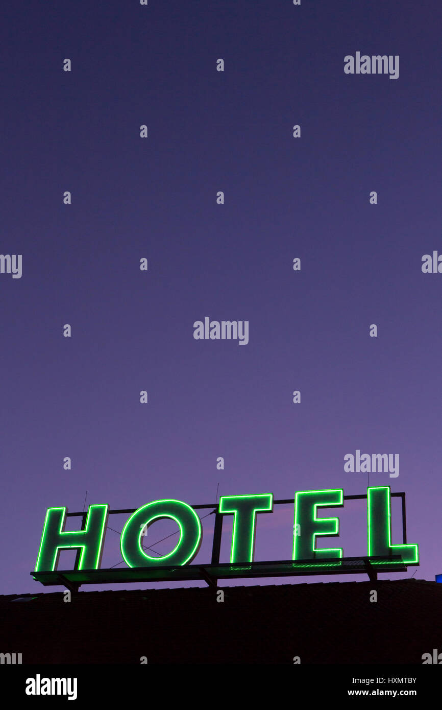 Green neon sign of a Hotel - Stock Image