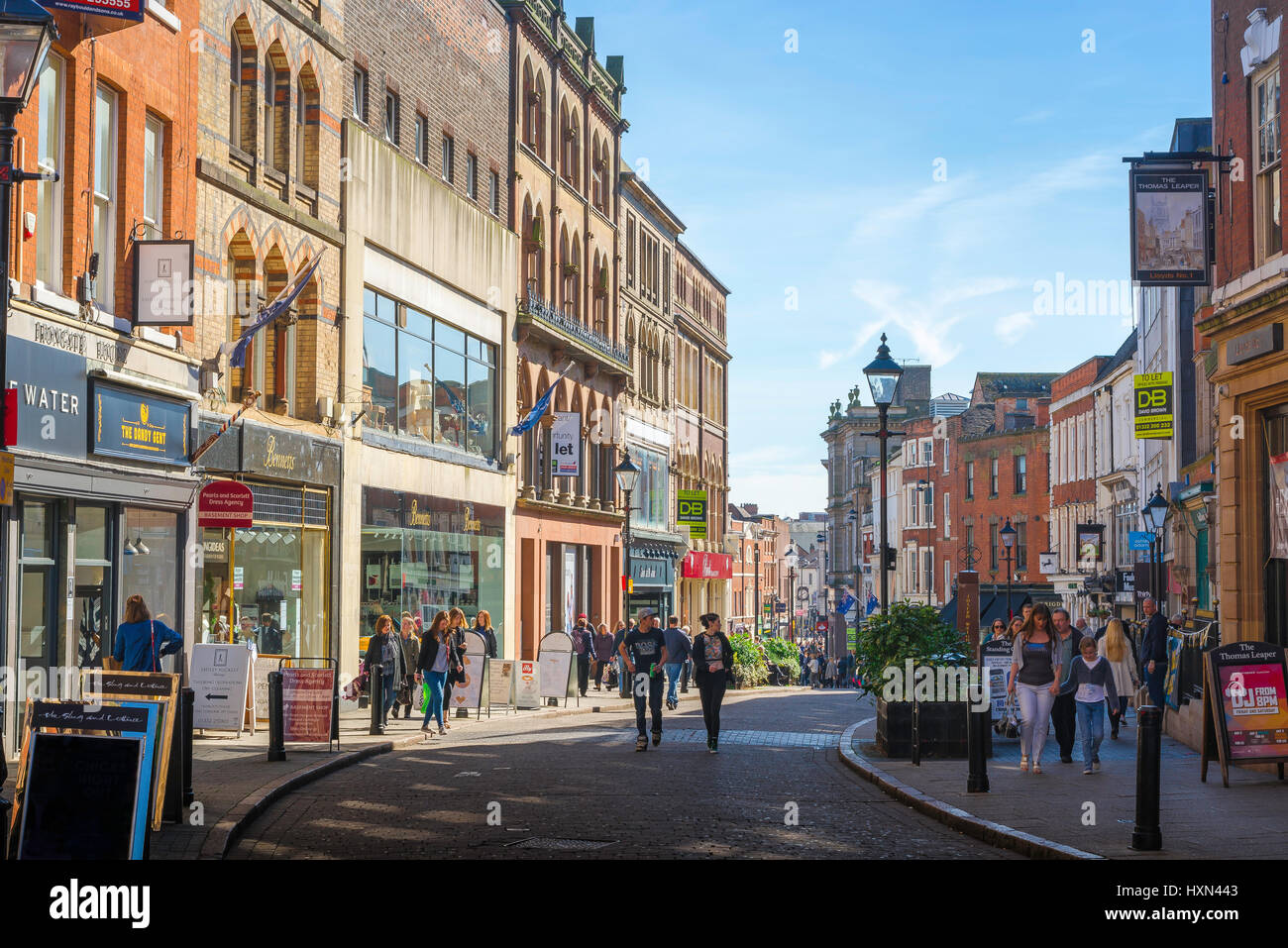 Derby city, the main shopping thoroughfare, called Iron Gate, runs through the centre of the city of Derby, Derbyshire, - Stock Image