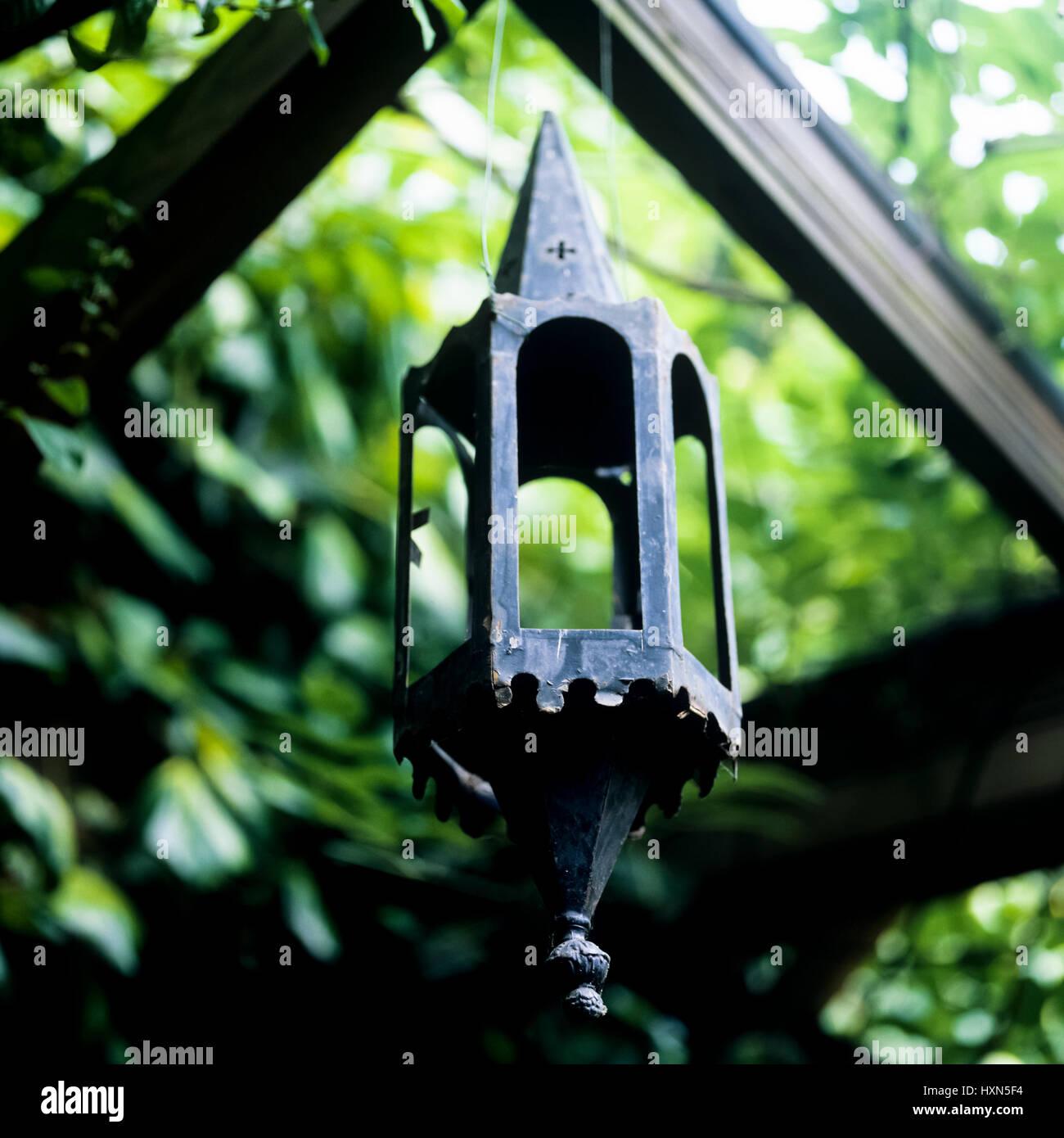 Metal lantern in garden. - Stock Image