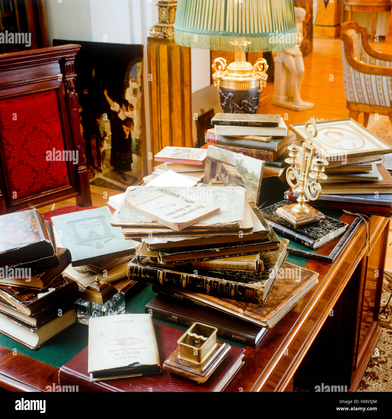 Books scattered on wooden desk Stock Photo: 136919068 - Alamy