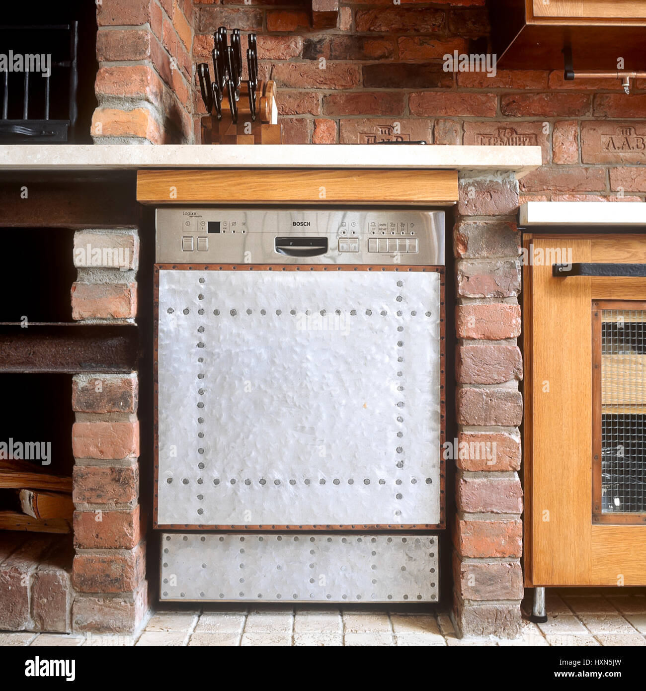 Oven and benchtop in rustic style kitchen. Stock Photo