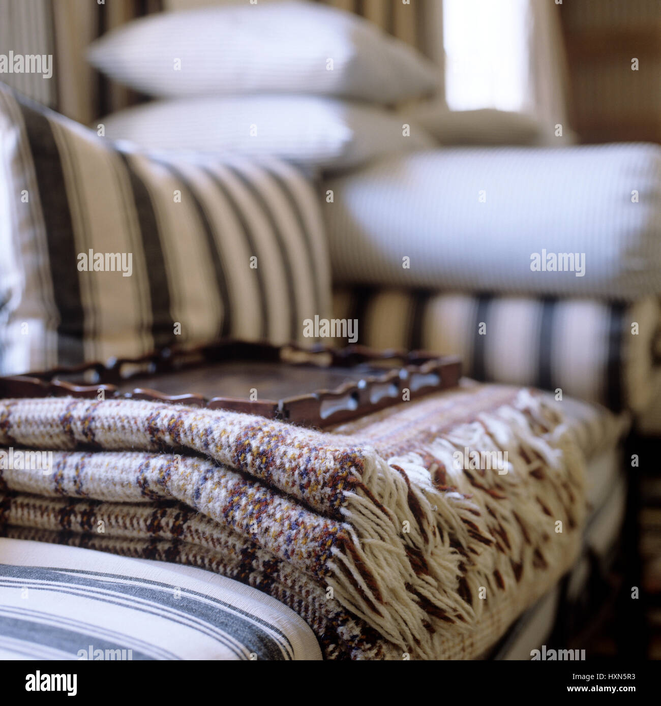 Blanket and tray on striped sofa Stock Photo: 136919191 - Alamy