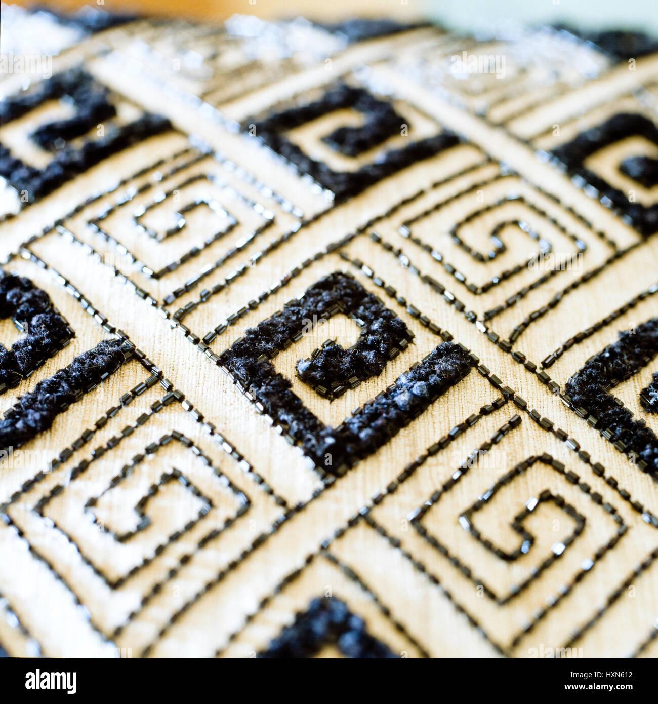 Black and white patterned cushion. - Stock Image