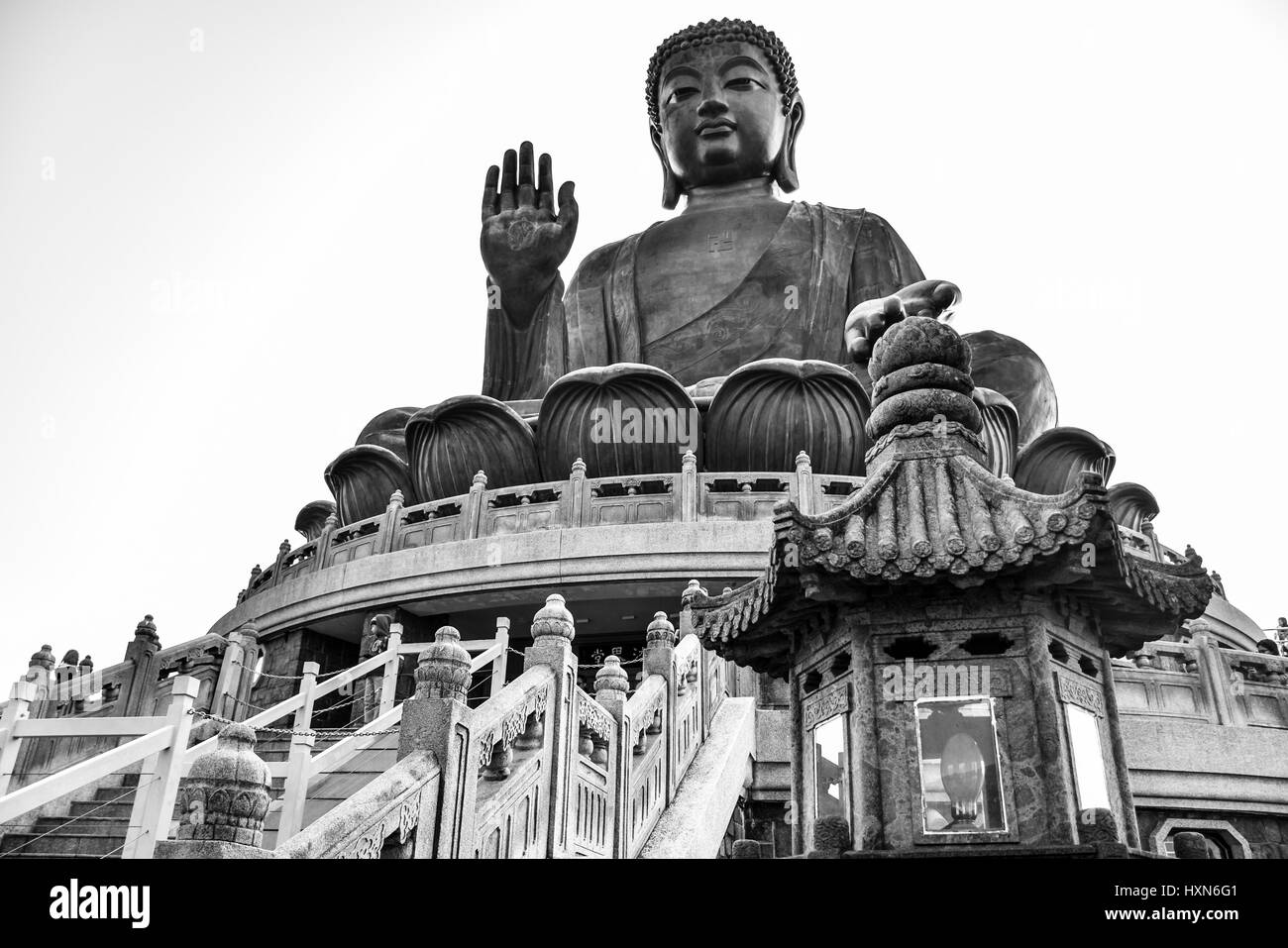 The enormous Tian Tan Buddha (Big Buddha) in black and white color at Po Lin monastery, Hong Kong with copy space - Stock Image
