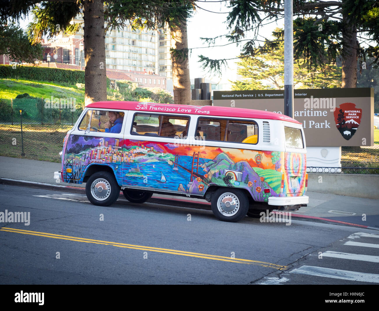 A San Francisco Love Tours Volkswagen bus (1972 VW bus, painted by Madison Tomsic, named 'Peace, Love, Freedom - Stock Image