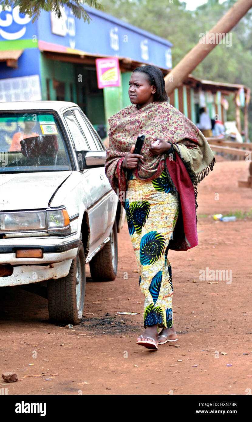 Makuyuni, Arusha, Tanzania - February 11, 2008: One unknown african  dark-skinned young woman dressed in ponchos - Stock Image
