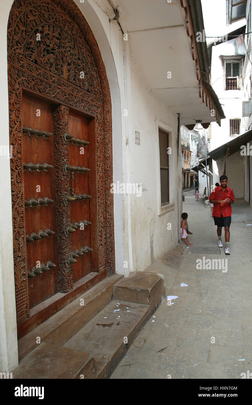 Zanzibar, Tanzania - February 16, 2008: Vintage traditional carved wooden doors in the houses on the narrow streets Stock Photo