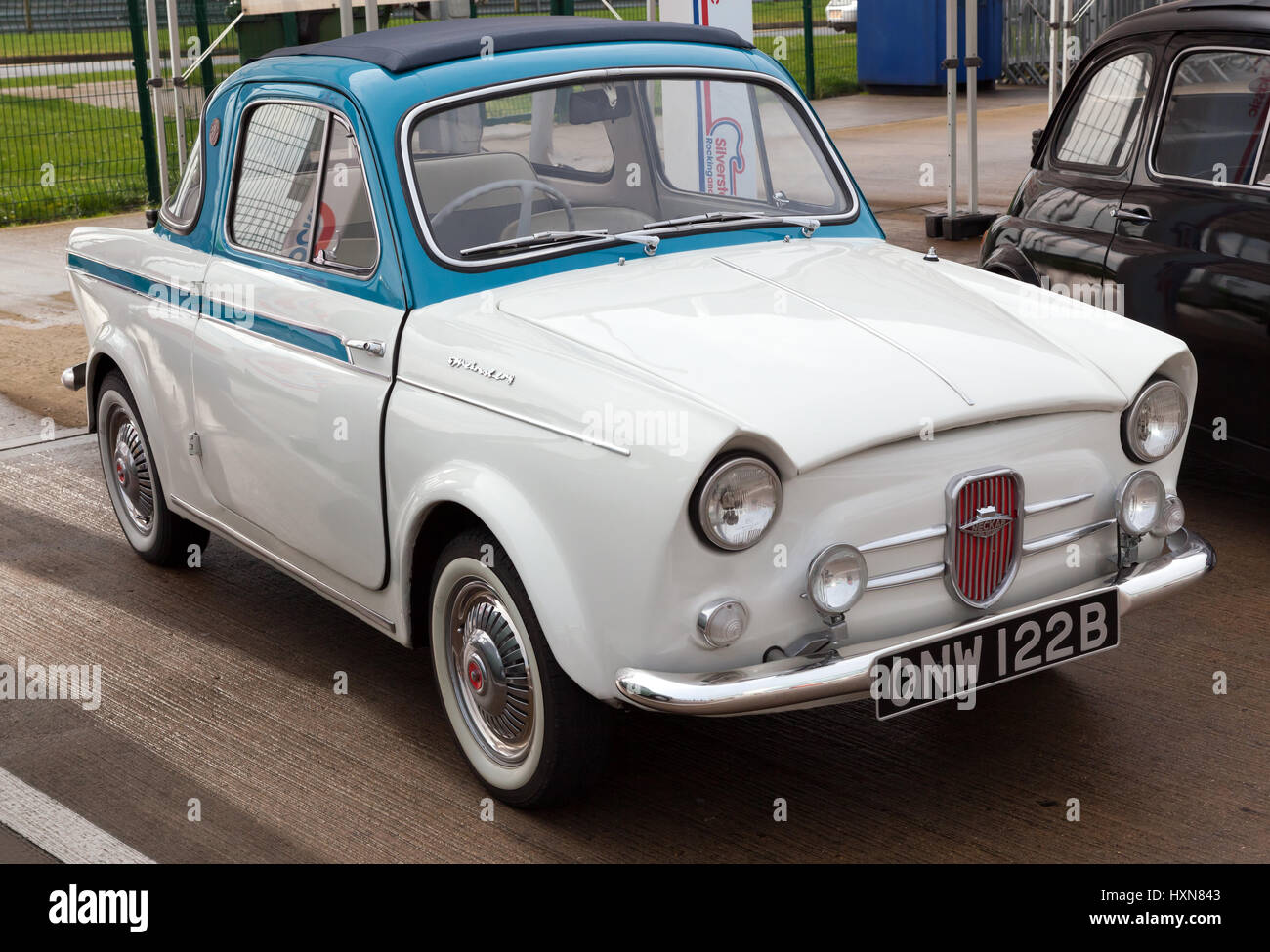 Three-quarter view of a NSU/Fiat Weinsberg 500, on display at the Silverstone Classic Media Day. - Stock Image