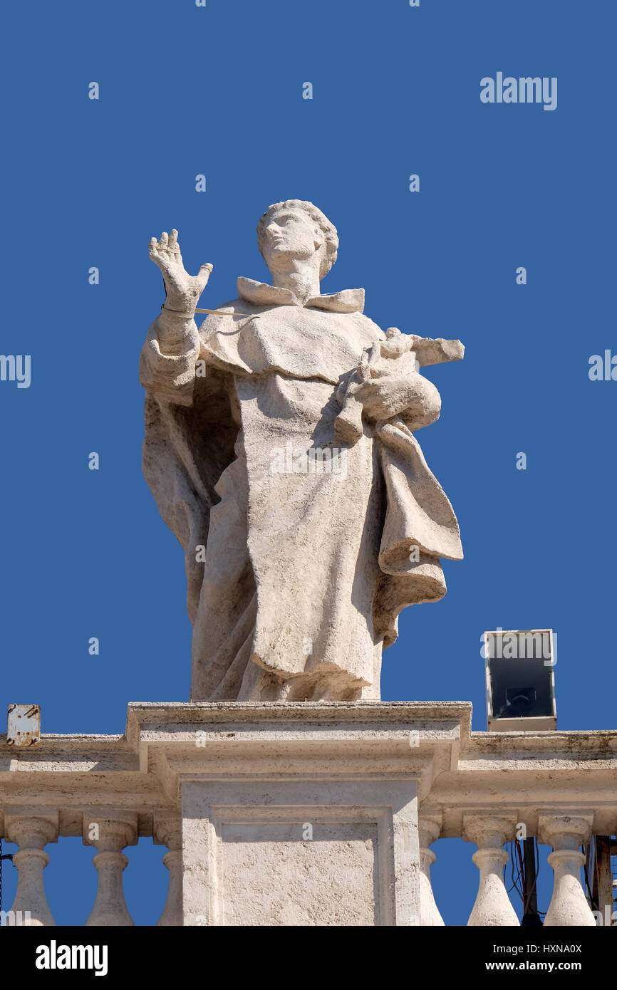 St. Louis Bertran, fragment of colonnade of St. Peters Basilica. Papal Basilica of St. Peter in Vatican, Rome, Italy - Stock Image