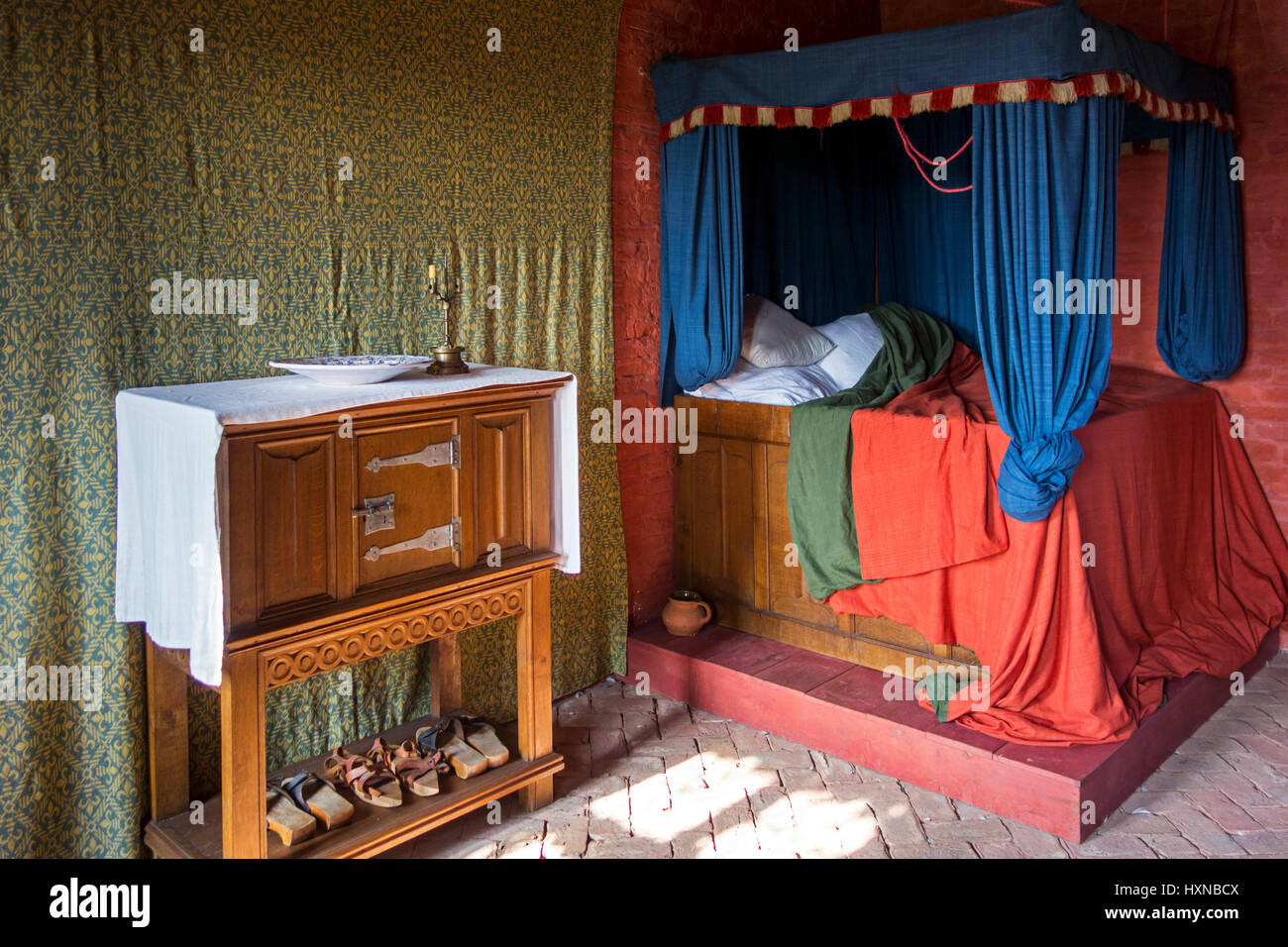 Colourful medieval curtained bedstead / bed from the Middle Ages with curtains - Stock Image