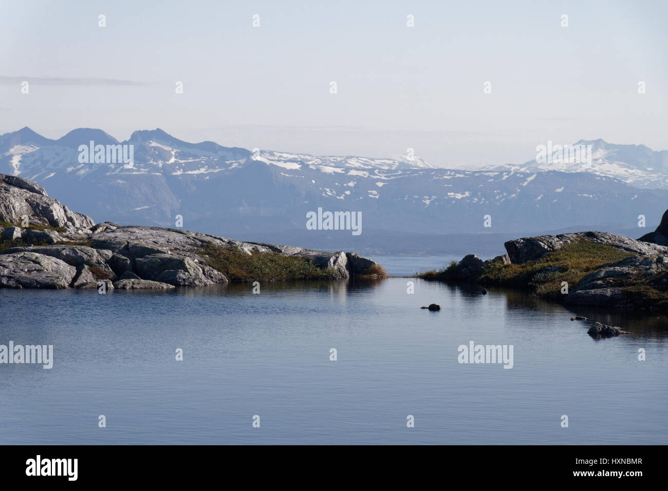Two water levels - lake above Bodø and the sea, near Steigtind - Stock Image