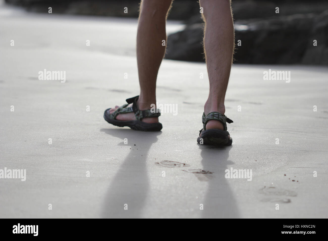 4322b26cd Young men feet on the beach wearing sandals Stock Photo  136924109 ...