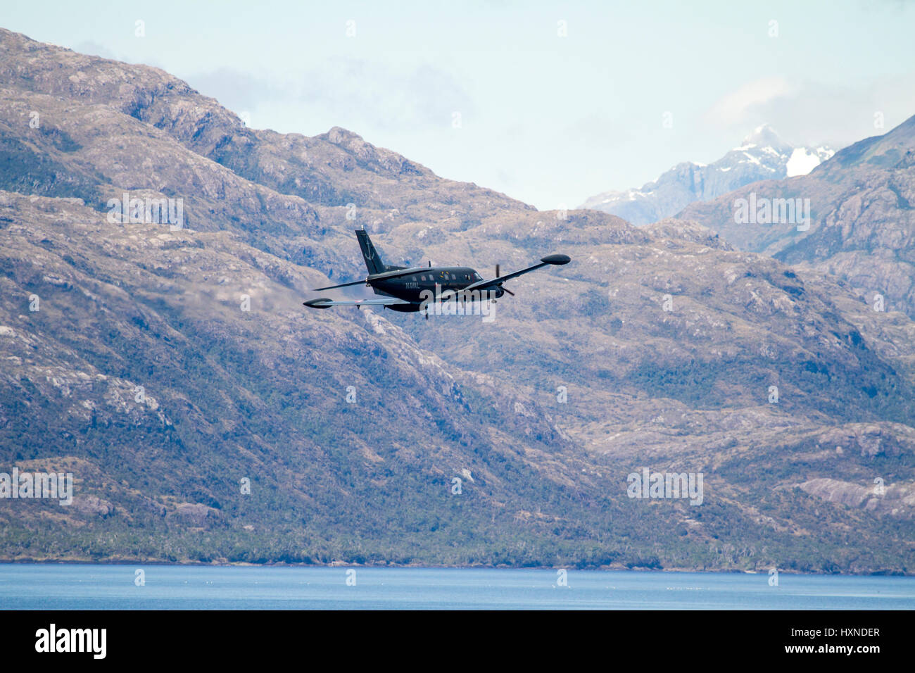 Military Plane in Chilean Fijords - South America - Patagonia - Aeroplane Inside The Passage Of The Chilean Fjords Stock Photo