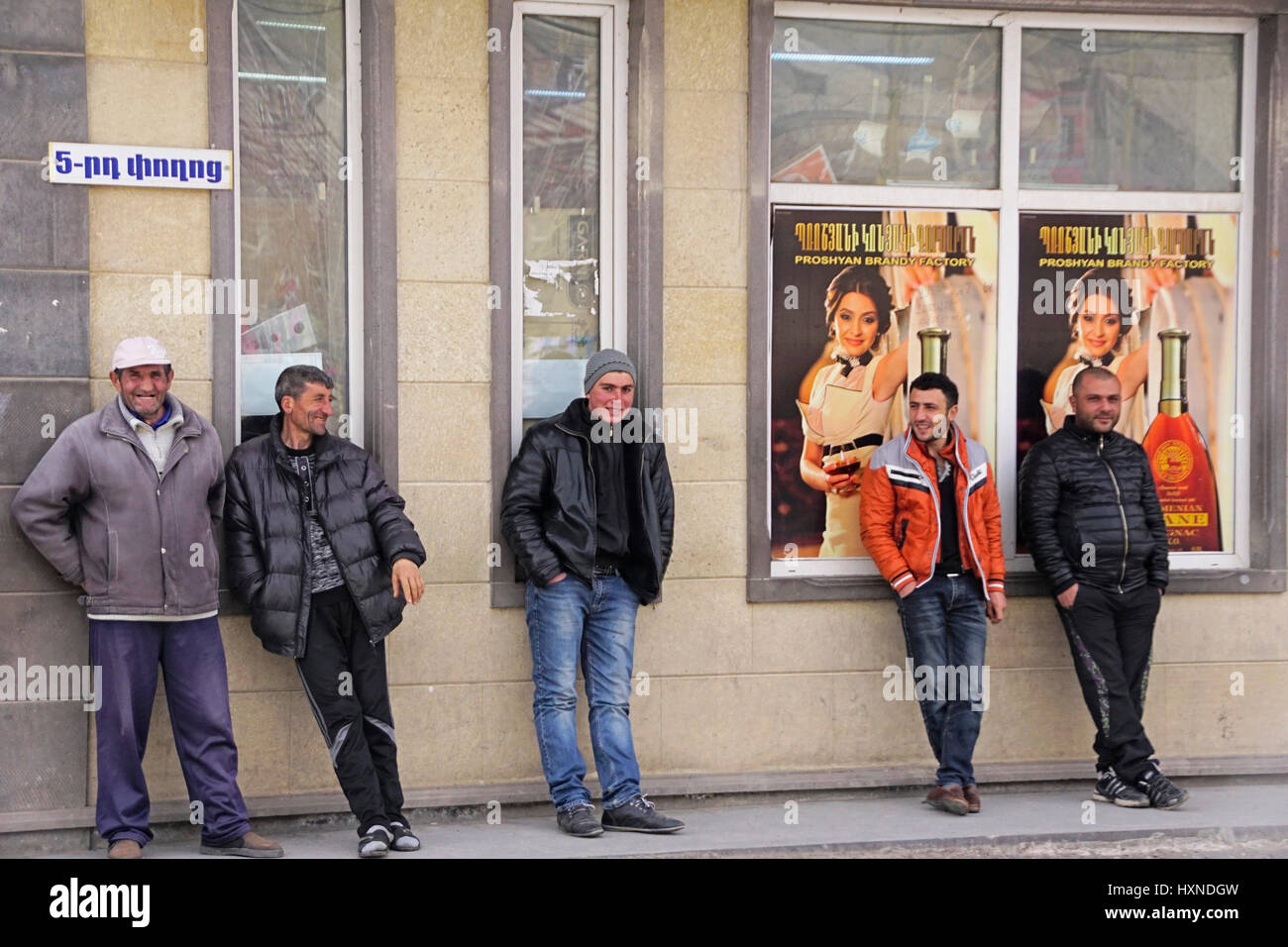 Unemployed Armenian men loitering on street in village of Goris. - Stock Image