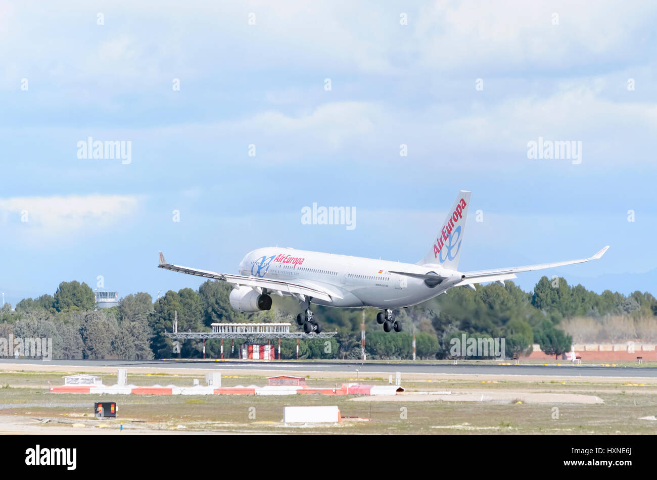 White plane Airbus A330, of Air Europa airline, is landing in Madrid - Barajas, Adolfo Suarez airport. Cloudy day - Stock Image