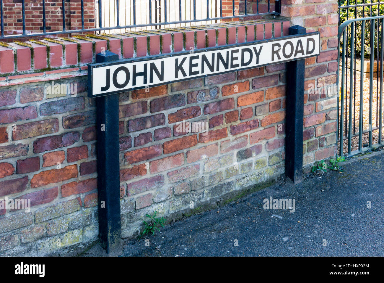 A street sign for John Kennedy Road in King's Lynn, Norfolk.  Named in honour of the American president following - Stock Image