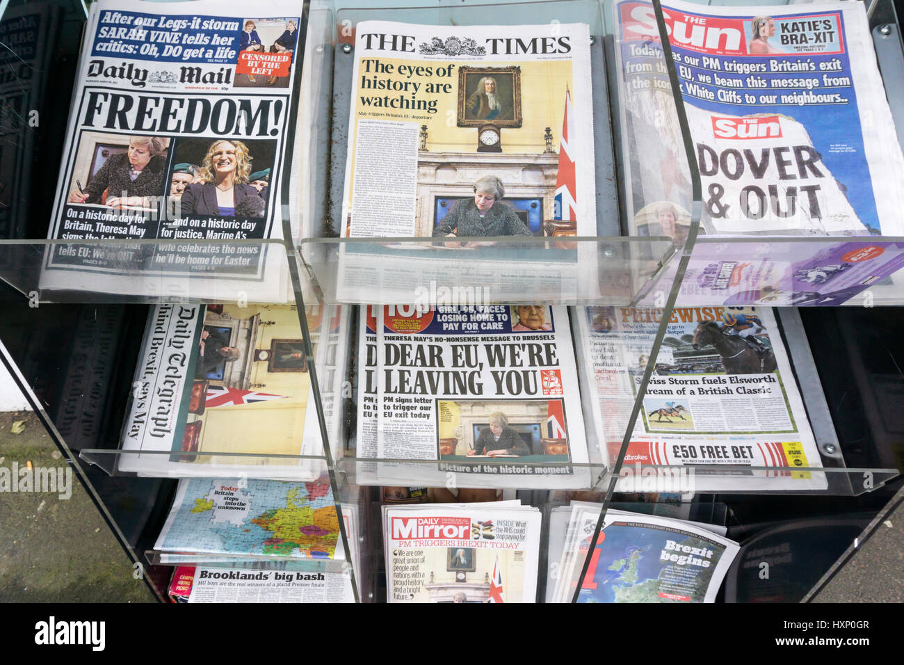The front pages of daily papers on the day that the UK triggers Article 50 to begin the process of leaving the EU. Stock Photo
