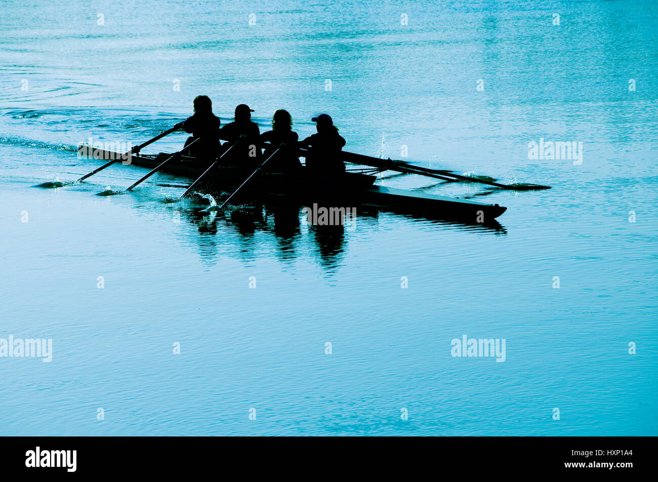 team of four women rowing - Stock Image