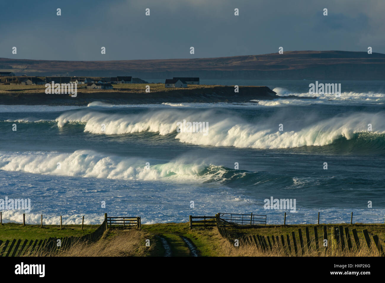 Large waves on the coast near the village of Mey, Caithness, Scotland, UK - Stock Image