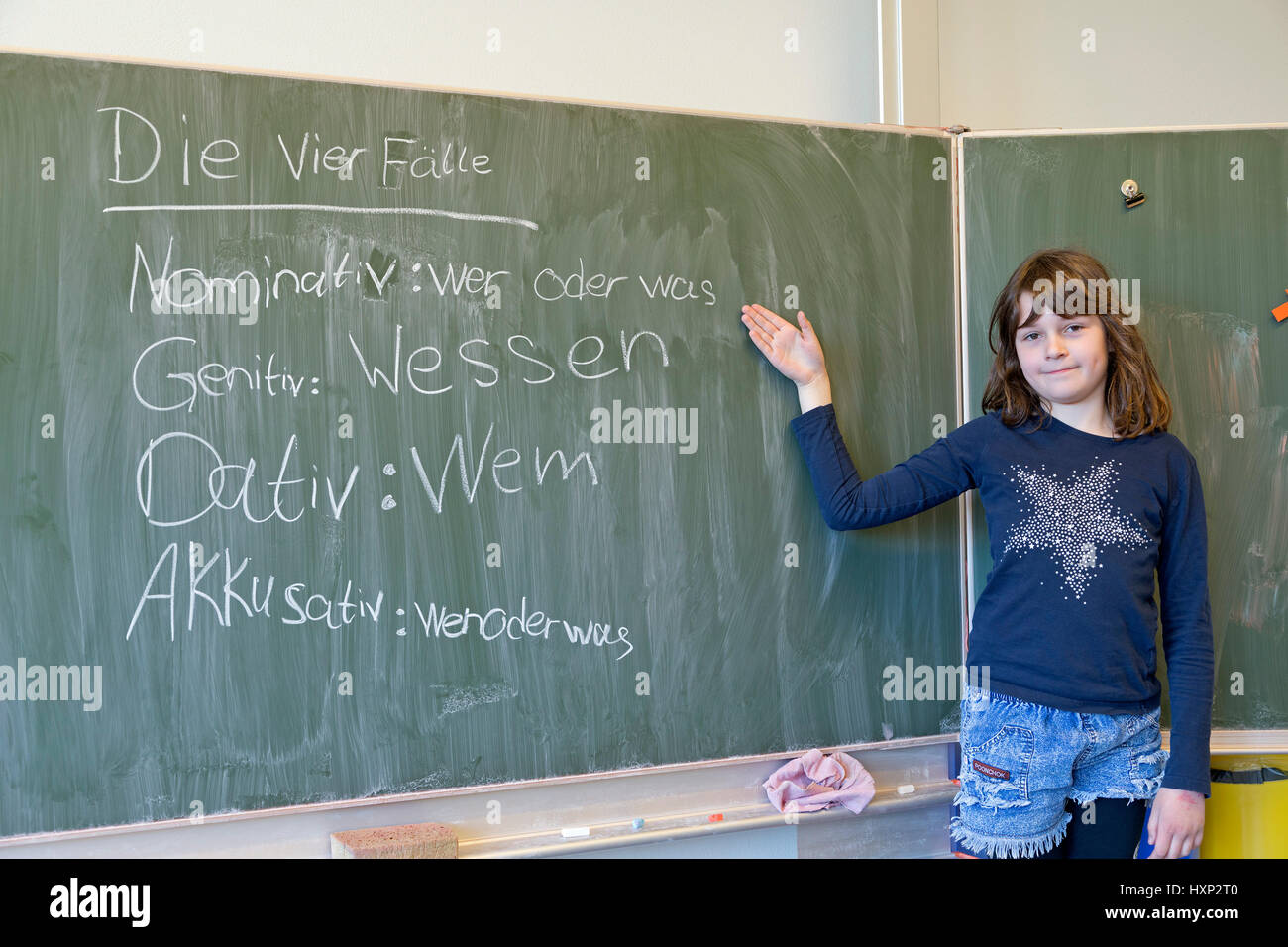 girl doing German grammar at primary school - Stock Image