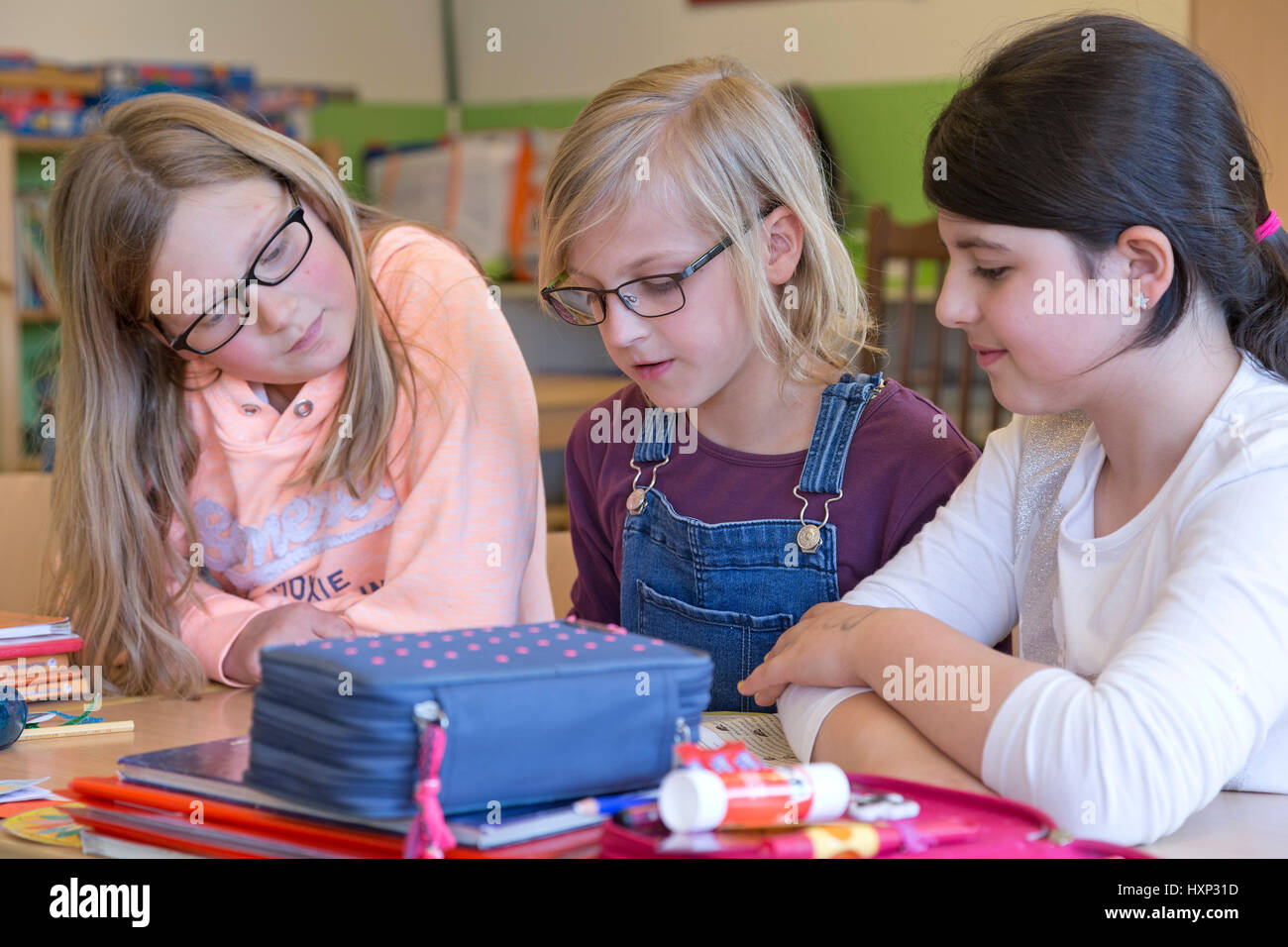 three girls working together at primary school Stock Photo