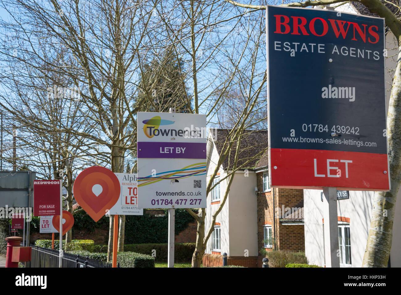 Estate agent signs outside flats, London Road, Englefield Green, Surrey, England, United Kingdom - Stock Image