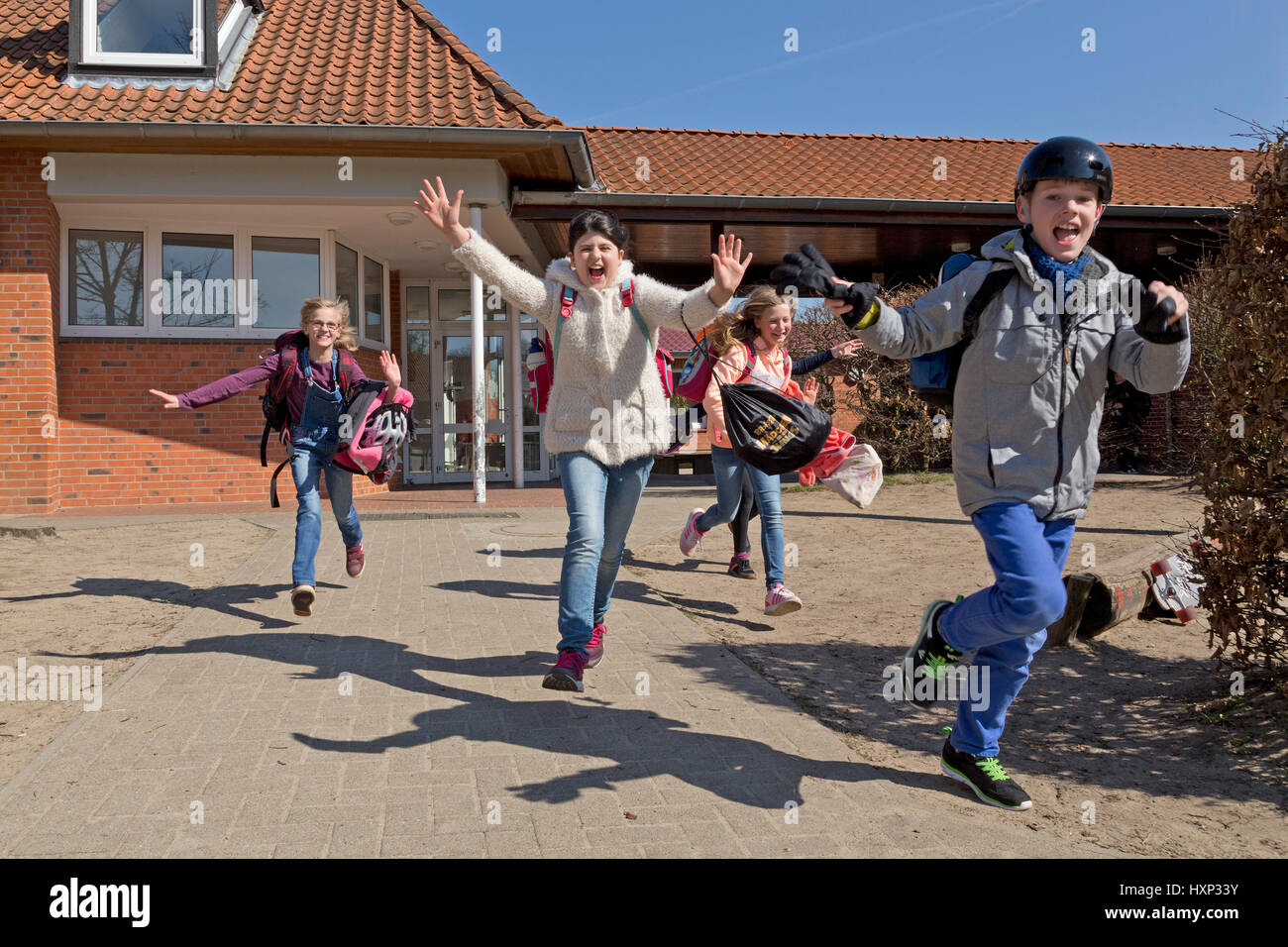 children at primary school running into their holidays - Stock Image